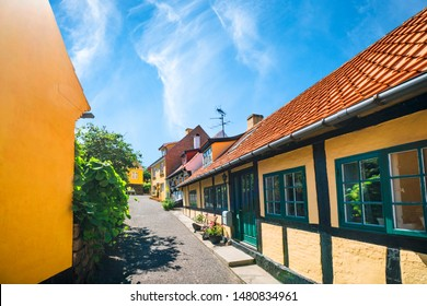 Idyllic village with yellow buildings under a blue sky in the summer