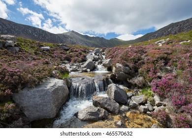 Idyllic waterfall in the Scottish Highlands on a beautiful Summer day, Isle of Arran, Goatfell mountain, Scotland.