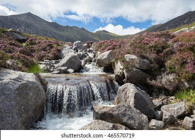 Idyllic waterfall in the Scottish Highlands on a beautiful Summer day, Isle of Arran, Goatfell mountain, Scotland.