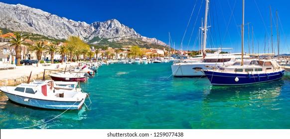 Idyllic waterfront of Baska Voda panoramic view, town in Makarska riviera of Dalmatia, Croatia - Shutterstock ID 1259077438