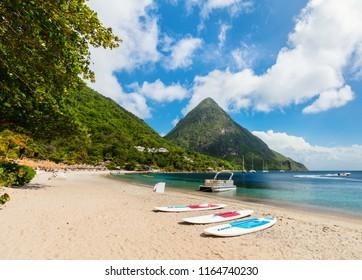 Idyllic white sand tropical beach with view to Piton mountains in Saint Lucia Caribbean
