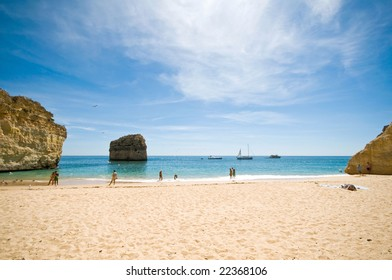 Idyllic wild beach in summertime. Algarve, Portugal.
