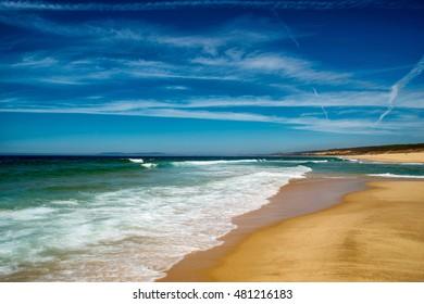 Idyllic wild beach in summertime. Atlantic Ocean, Portugal.