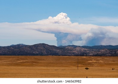 IDYLLWILD, CA -JULY 17:  Raging 22,000 acre wild fire rises above Idyllwild, CA on July 17, 2013. This photo of the gigantic smoke cloud was taken over 40 miles away in Warner Springs, CA.