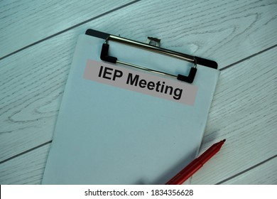 IEP Meeting write on a paperwork isolated on office desk. Selective focus on IEP Meeting Text