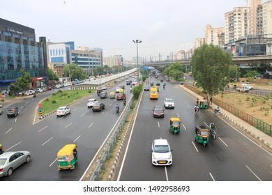Iffco chowk, Gurugram, India - 25 July, 2019:  cityscape, different mode of travels, Road transportation, metro, buildings