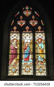 Iffendic, France - September 9, 2016: Stained glass window in the Church of Saint Eloi in Iffendic, France. Place adoption by St Louis Marie de Montfort First Holy Communion.