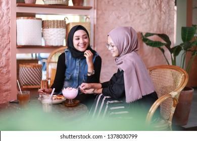 iftar ramadan two asian women. yogyakarta indonesia. april 23, 2019.