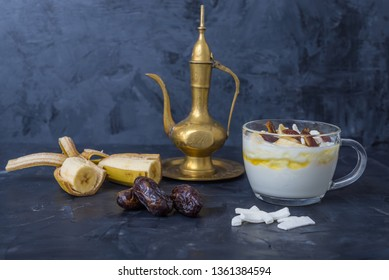 Iftar or Suhoor snack close up of dates with yogurt and bananas honey and dates  on black background , Ramadan concept