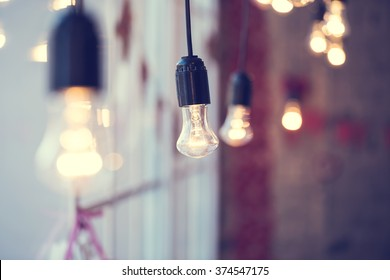 iful festoon light bulb hanging at the window. Lighting decor
