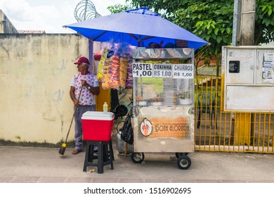 """Igarassu, Brazil - Circa August 2019: Street vendor selling typical Brazilian snacks like """"Pastel"""" and """"Coxinha"""" for 1 real in the historic center of Igarassu"""