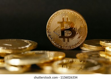 igital Currency. Gold Bitcoin Coins On Dark Background