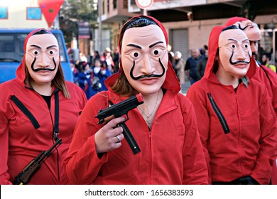 Iglesias / Italy - February 22 2020: masks at the carnival parade inspired by the TV serie Money heist