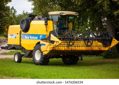 Ignalina/Lithuania August 9, 2019 Combine harvester NEW HOLLAND  TC5050 New Holland is a global brand of agricultural machinery produced by CNH Industrial.