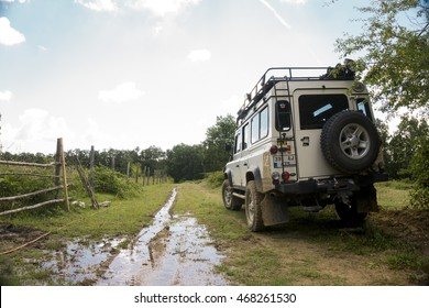 IGNEADA, KIRKLARELI - JUL 8, 2016 Land Rover Defender on dirty road. The iconic and legendary Land Rover Defender was issued in 1983. It goes out of production in Dec. 2015.