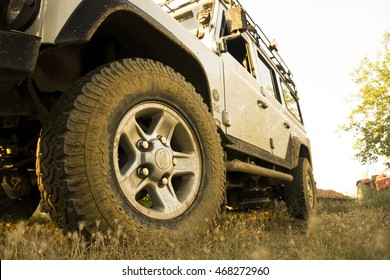 IGNEADA, KIRKLARELI - JUL 8, 2016 Land Rover Defender's wheel on dirty road. The iconic and legendary Land Rover Defender was issued in 1983. It goes out of production in Dec. 2015.