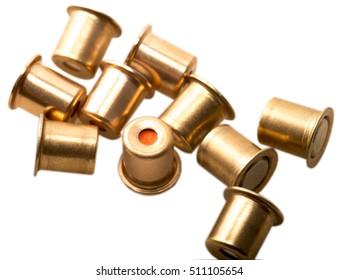 Igniter capsules of 12 gauge cartridges isolated. Hard light.