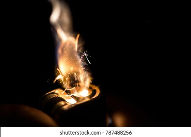 Igniting a lighter on a black background