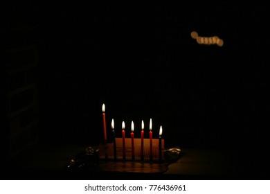 Ignition Chanukah candles in celebration of Hanukkah