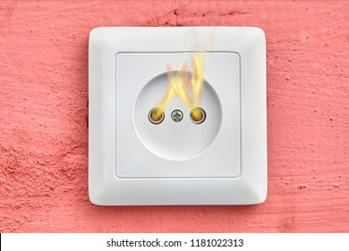 Ignition of a faulty household wall outlet, close-up.