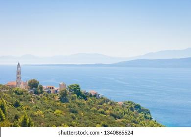 Igrane, Dalmatia, Croatia, Europe - Church spire on top of the mountain of Igrane