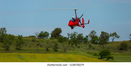 IGUALADA, SPAIN - MAY 20, 2018: Light airplane demonstrating flying capabilities in sky of Igualada-Odena aerodrome on 26th airshow Aerosport