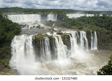 Iguassu falls (Iguazu/Iguacu) of the Parana river and a rainbow, Misiones, Argentina viewed from Brazil.