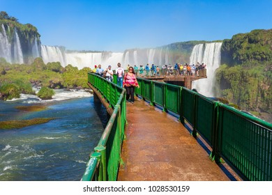 IGUAZU, ARGENTINA - MAY 02, 2016: Unidentified tourists at the Iguazu Falls. It's one of the New 7 Wonders of Nature, located on the border of Brazil and Argentina.