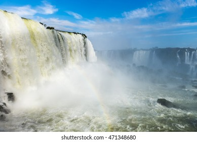 The Iguazu Falls with clouds and blue sky on the background in Foz do Iguacu, Brazil
