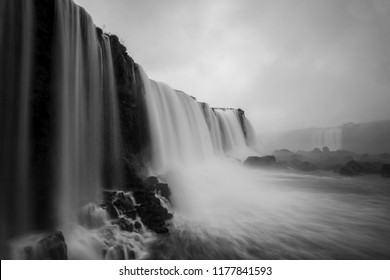 Iguazu Falls or Iguacu Falls, Devil's Throat or Garganta Del Diablo, seen from the viewpoint at Iguazu National Park, Brazil, South America, long exposure black and white