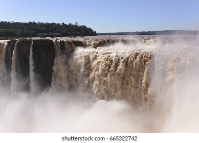 Iguazu Falls on the Argentina and Brazil Borders, vast waterfall with river, UNESCO. Devil's Throat.
