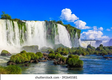 Iguazu Falls on the background of blue sky, Brazil side