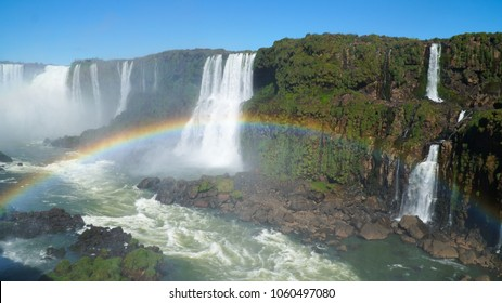 Iguazu Falls Waterfall with Rainbows and Spray as seen from the Brazil Side.