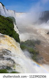 Iguazu Falls or Iguaçu Falls are waterfalls of the Iguazu River on the border of the Argentine province of Misiones and the Brazilian state of Parana, with colorful rainbow
