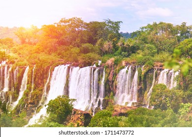 Iguazu waterfalls in Argentina, view from Devil's Mouth, water steam over Iguazu river. Toned image with flare.