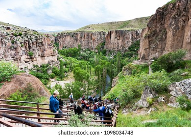 IHLARA VALLEY, TURKEY - MAY 6, 2018: people on stair to Ihlara Valley in Aksaray Province. Ihlara Valley is 16 km long gorge, it is the most famous valley in Turkey for hiking excursion