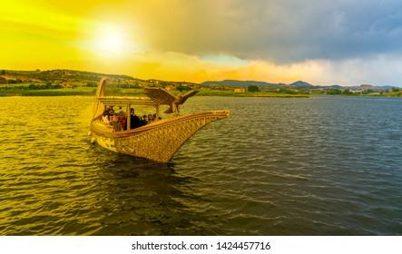 Ihsaniye, Afyonkarahisar/Turkey-June 08 2019: Boat in Lake Emre in sunset, Phrygia Valley Natural Park (Frig Vadisi Tabiat Parki) sunset in Phrygia Valley Natural Park (Frig Vadisi Tabiat Parki)