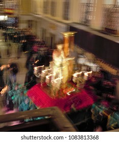 Iimage of Jesus Christ tied to the column and flagellated in a step of Holy Week Easter week, holy Week, Impressionist artistic photography with circular movement of the camera to obtain that effect