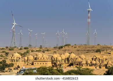 IINDIA, RAJASTHAN, JAISALMER, 2013-12-26: Chattris of Bada Bagh near Jaisalmer surrounded by wind generators