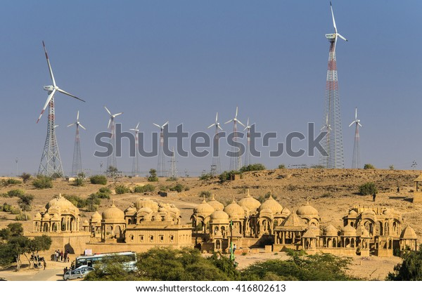 IINDIA, RAJASTHAN, JAISALMER, 2013-12-26: Chattris of Bada Bagh near Jaisalmer surrounded by wind generators
