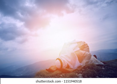 The iIslamic man praying   on the mountain.