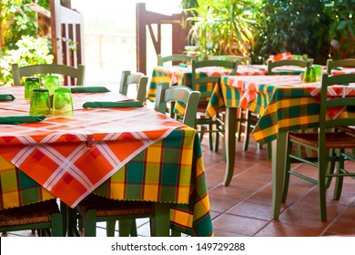 IItalian trattoria interior with wooden tables and chairs