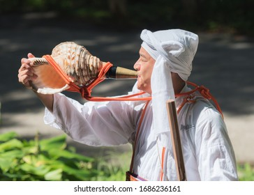 Iiyama, Nagano / JAPAN - SEPTEMBER 4th 2018: A Yamabushi (mountain priest)  in front of the entrance of the 'God's Forest' in Kosuge.