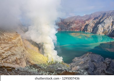 Ijen, Banyuwangi Regency, Java, Indonesia - February  9 2015: Sulfurous smokes from the volcano are the source of the sulfur mine. The water of the lake is highly aciduous.