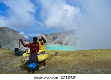 Ijen Crater - 7 December 2018: Sulfur miners at Mount Ijen who are gathering sulfur in Banyuwangi, Indonesia