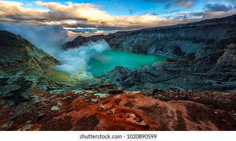 Ijen Crater (Kawah Ijen), located on the island of East Java, famously contains the world's largest  acidic volcanic crater lake. By day, the steaming waters of the lake take on a brilliant teal color