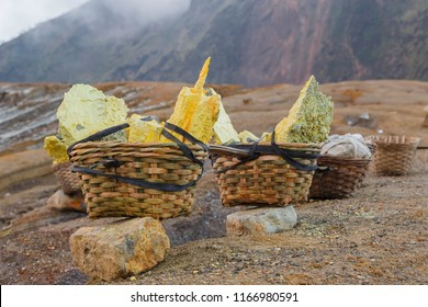 Ijen Volcano, Banyuwangi Regency, Java, Indonesia - February  9 2015: A typical 90-kg-load of sulfur from the floor of the volcano which is usually carried by a single sulfur miner.