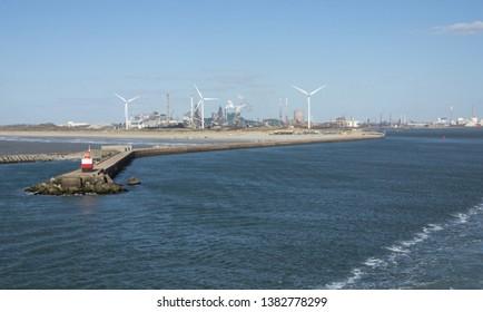 Ijmuiden, Netherlands - 31 March 2019: Ijmuiden Jetty and Former Koninklijke Hoogovens,  Currently Tata Steel Factory and Wind Mills on Shore