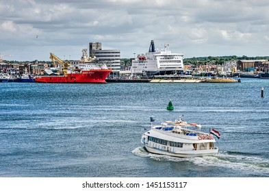 IJmuiden, the Netherlands, July 14, 2019: ferry boat for pedestrians and cyclists crossing the North Sea Canal from the pier at Velsen North