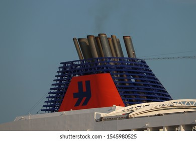 IJmuiden, the Netherlands -July 27th 2018: MS Europa 2, operated by Hapag-Lloyd Cruises, leaving IJmuiden sea lock, detail of funnel with company logo